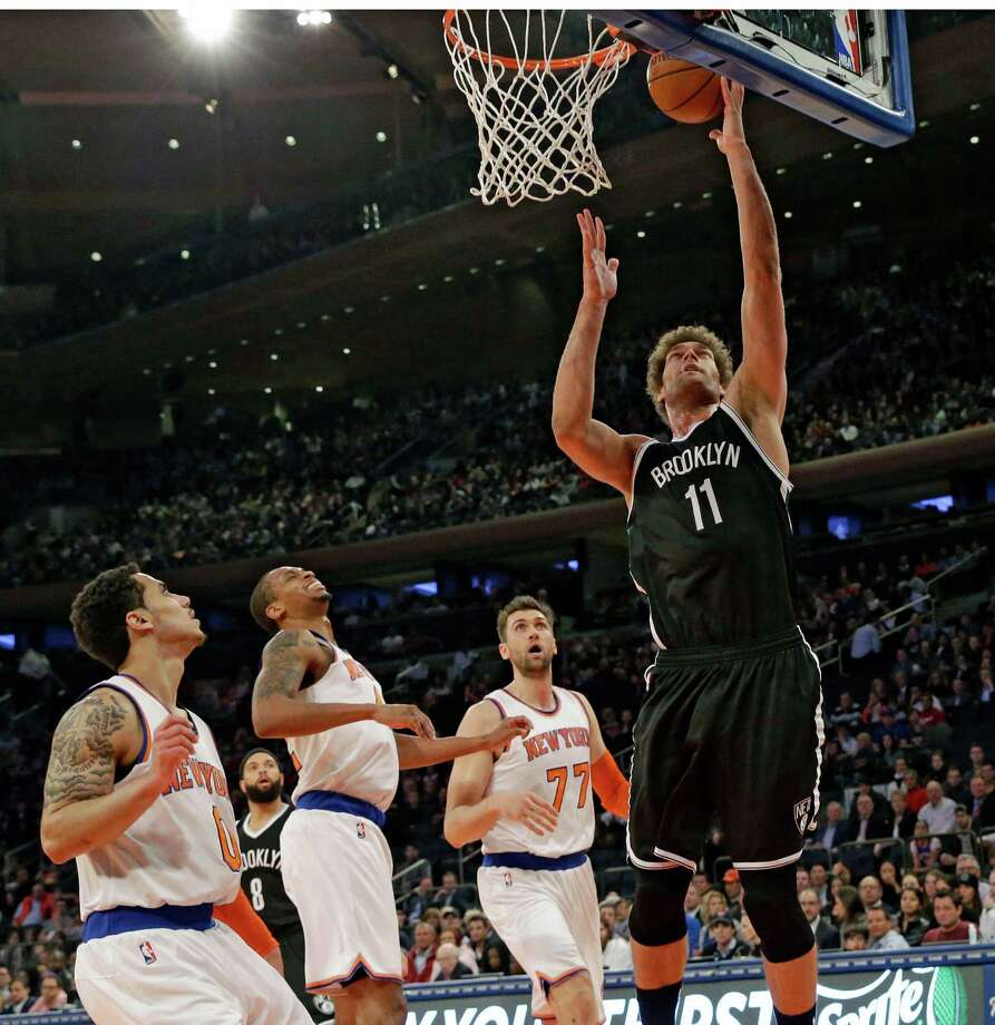Brooklyn Nets center Brook Lopez (11) goes to the basket during the first half of an NBA basketball game against the New York Knicks, Wednesday, April 1, 2015, at Madison Square Garden in New York.  (AP Photo/Mary Altaffer) ORG XMIT: MSG106 Photo: Mary Altaffer / AP