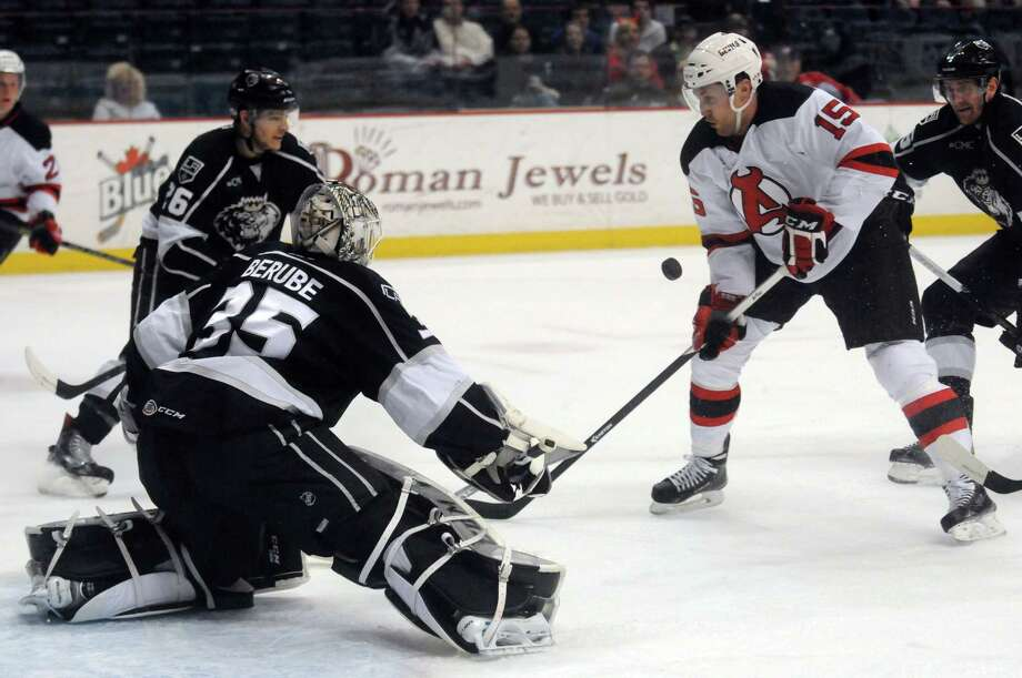 The Devils Paul Thompson can't get the puck by Manchester goalie Jean-Francois Berbe during their hockey game at the Times Union Center on Wednesday April 1, 2015 in Albany, N.Y. (Michael P. Farrell/Times Union) Photo: Michael P. Farrell / 00030124Q