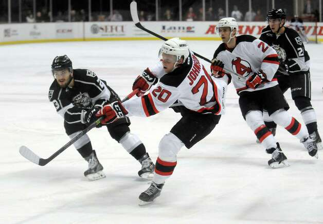 The Devils Ben Johnson takes a shot on goal during their hockey game against Manchester at the Times Union Center on Wednesday April 1, 2015 in Albany, N.Y. (Michael P. Farrell/Times Union) Photo: Michael P. Farrell / 00030124Q