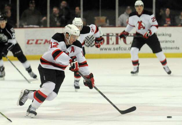 The Devils Tim Sestito brings the puck up the ice during their hockey game against Manchester at the Times Union Center on Wednesday April 1, 2015 in Albany, N.Y. (Michael P. Farrell/Times Union) Photo: Michael P. Farrell / 00030124Q