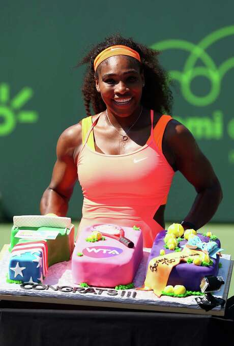 KEY BISCAYNE, FL - APRIL 01:  Serena Williams of the United States poses for a photograph with a cake to celebrate her 700th WTA Tour win after her three set victory against Sabine Lisicki of Germany in their quarter final match during the Miami Open Presented by Itau at Crandon Park Tennis Center on April 1, 2015 in Key Biscayne, Florida.  (Photo by Clive Brunskill/Getty Images) Photo: Clive Brunskill, Staff / 2015 Getty Images
