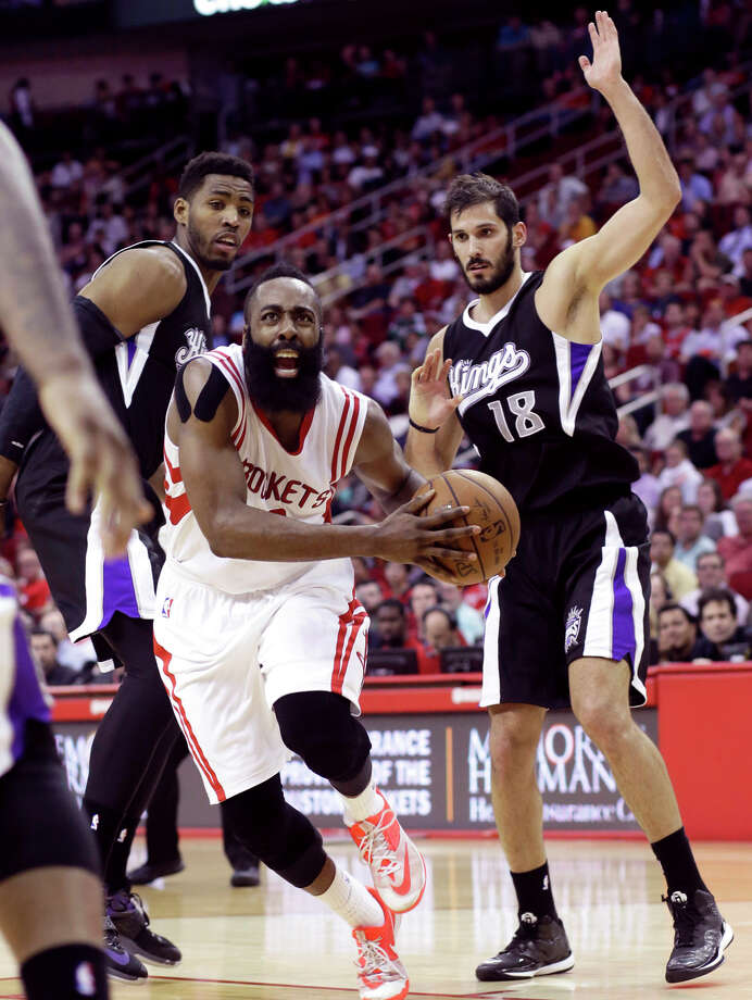 The Rockets' James Harden drives between the Kings' Jason Thompson (left) and Omri Casspi. Harden had 51 points. Photo: Pat Sullivan / Associated Press / AP