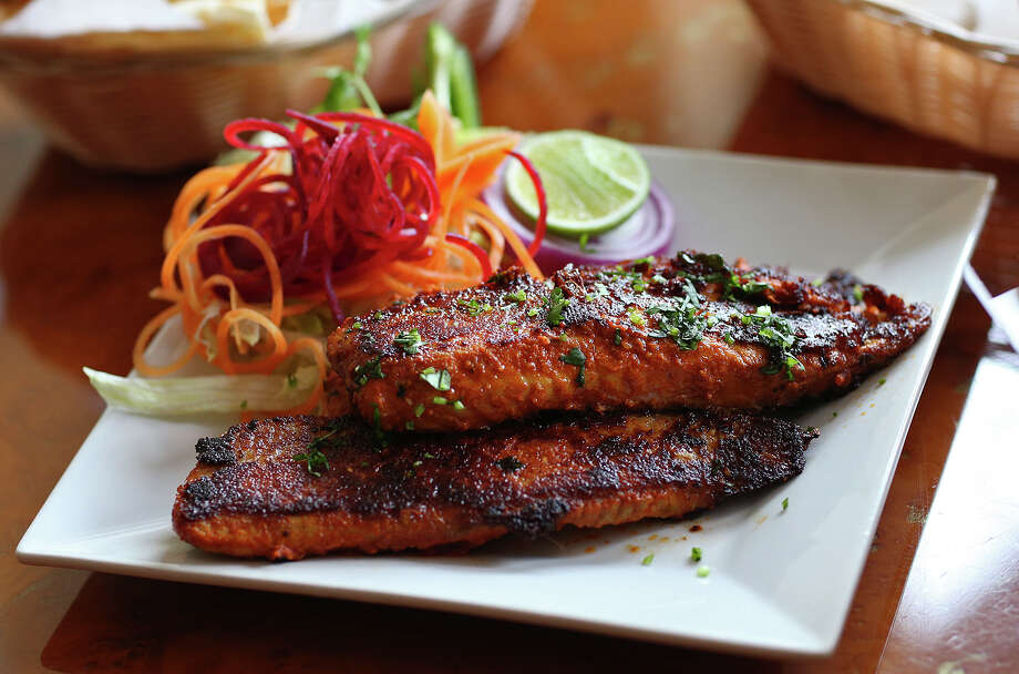 Tawa fish, an item on the appetizer list, is coated with a mixture of spices and cooked in a traditional shallow pan. Photo: Jerry Lara /San Antonio Express-News / © 2015 San Antonio Express-News