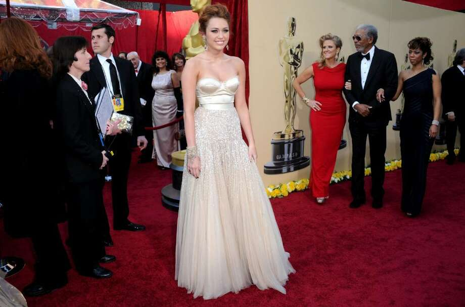 HOLLYWOOD - MARCH 07:  Singer/actress Miley Cyrus arrives at the 82nd Annual Academy Awards held at Kodak Theatre on March 7, 2010 in Hollywood, California.  (Photo by Jason Merritt/Getty Images) *** Local Caption *** Miley Cyrus Photo: Jason Merritt, Getty Images / 2010 Getty Images