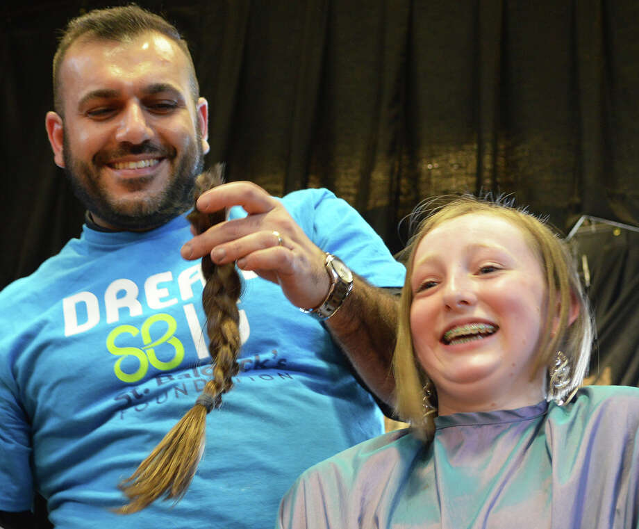Jessica Lee, 13, said goodbye to her ponytail as her hair was sheared at the Team Teddy St. Baldrick's fundraiser at Osborn Hill School. Photo: Jarret Liotta / Fairfield Citizen
