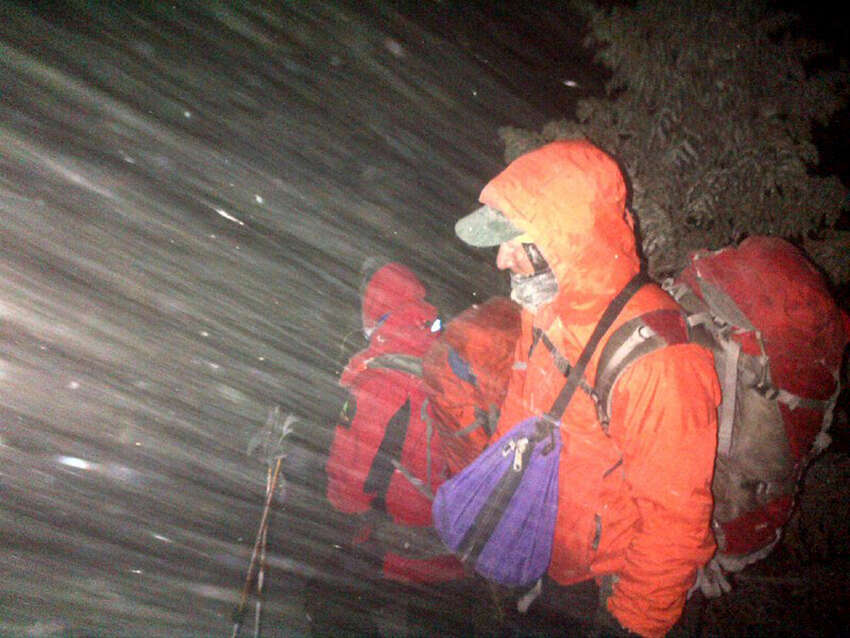 New York State Department of Environmental Conservation Forest Rangers search for a mother and her two sons on Mt. Marcy Saturday night, March 14, 2015, in Essex County, N.Y. (New York State DEC)