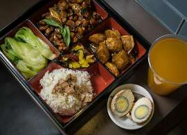 The Three-Cup Chicken with a Tea Egg and a Mango Green Tea Ice Tea at Redi to Go in San Mateo, Calif.,  is seen on April 1st,  2015.