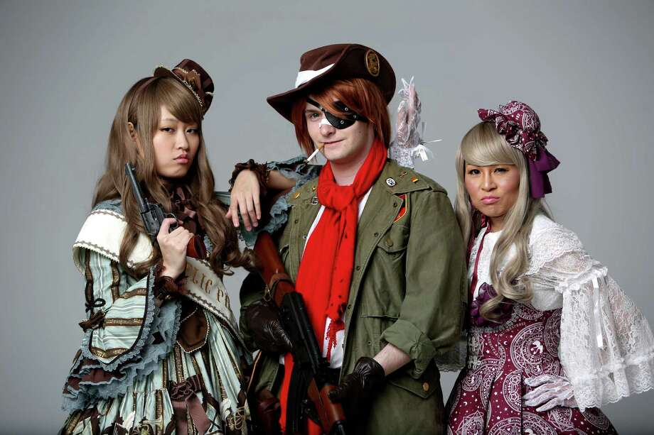 Ying Huang, 23, Cris Amador, 21, as Pip Bernadette from Japanese Anime Hellsing, and Deneice Leigh, convention founder, dressed in Lolita fashion for Anime Matsuri fashion Tuesday, March 31, 2015, in Houston, Texas. Upcoming convention at the George R. Brown Convention center April 3-5, 2015. ( Gary Coronado / Houston Chronicle ) Photo: Gary Coronado, Staff / © 2015 Houston Chronicle