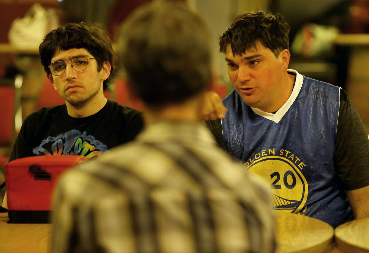 John Hammond (right) and Noah Tenney listen to a discussion about autism matters. A meeting of the AASCEND, which is a group in the autism spectrum, met at the The Arc in San Francisco, Calif. Wednesday April 1, 2015.