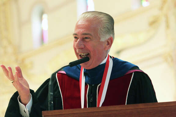 UIW President Lou Agnese enjoys the audience as he is re-inaugurated at the Incarnate Word chapel on March 25, 2011.