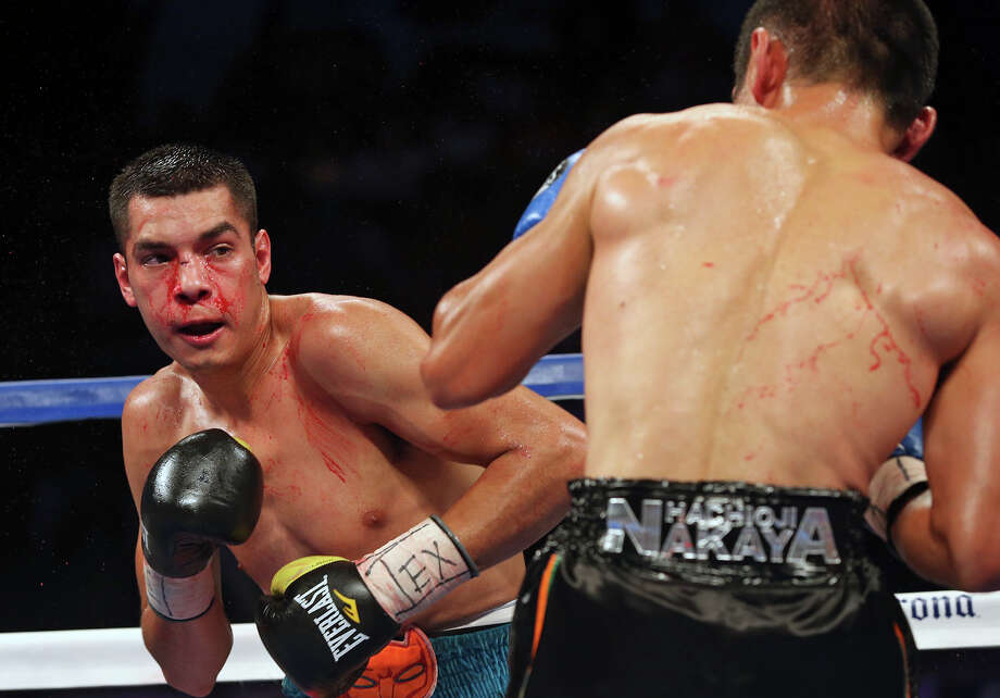 Omar Figueroa (left) battles Nihito Arakawa during the Knockout Kings II boxing card at the AT&T Center on July 27, 2013. Photo: Tom Reel /San Antonio Express-News / San Antonio Express-News