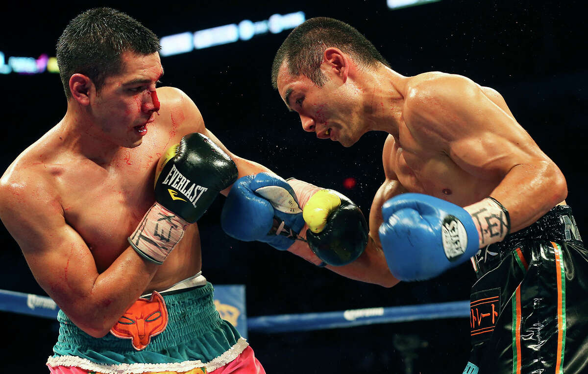 Omar Figueroa (left) battles Nihito Arakawa during the Knockout Kings II boxing card at the AT&T Center on July 27, 2013.