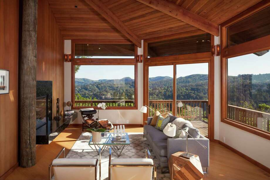 The living room features wood-paneled walls, and a radial ceiling with exposed beams. Click here to see more Mill Valley listings. Photo: Jacob Elliott Photography / ONLINE_CHECK