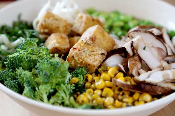 Signature Vegetarian Bowl with smoked tofu, Ramen noodles, shiitake mushrooms, bok choy, bean sprouts, grilled corn, green peas, edamame, broccoli, fried onion, and vegetable broth at the Ramen bar at Whole Foods Market, 1407 S. Voss Road, Wednesday, April 1, 2015, in Houston, Texas. ( Gary Coronado / Houston Chronicle )