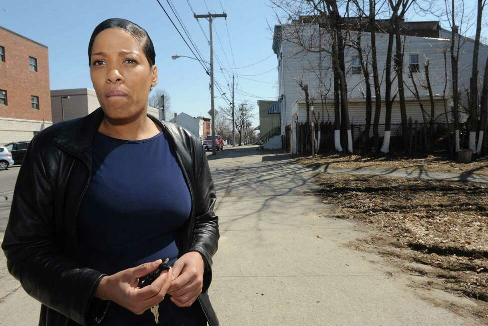 Celestal Hightower stands at the scene and talks about her cousin, Donald