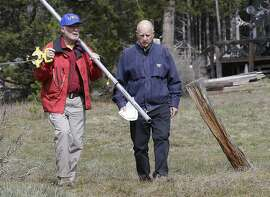 Frank Gehrke, left, chief of the California Cooperative Snow Surveys Program for the Department of Water Resources, and Gov. Jerry Brown walk across a dry meadow that is usually covered in several inches of snow as conducts the snow survey, near Echo Summit, Calif., Wednesday, April 1, 2015. Gehrke said this was the first time since he has been conducting the survey that he found no snow at this location at this time of the year.  Brown took the occasion to annouced that he signed an executive order requiring the state water board to implement measures in cities and towns to cut water usage by 25 percent compared with 2013 levels. (AP Photo/Rich Pedroncelli)