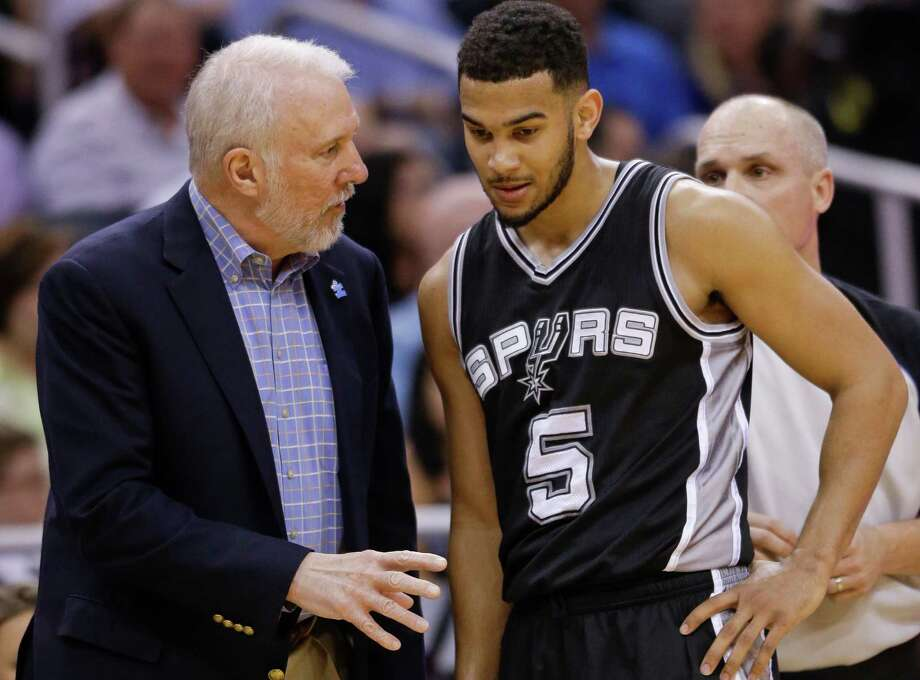 Spurs head coach Gregg Popovich talks with Cory Joseph during a timeout in the second half on April 1, 2015, in Orlando, Fla. San Antonio won 103-91. Photo: John Raoux /Associated Press / AP