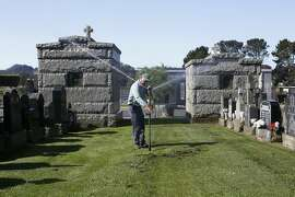 Groundskeeper Filiberto Garcia adjusts a sprinkler in the Italian Cemetery in Colma, CA, on Thursday, April 2, 2015. Many cemeteries will have to adapt after California Governor Jerry Brown announced on Wednesday that water agencies in the state will be required to cut usage by 25 percent.