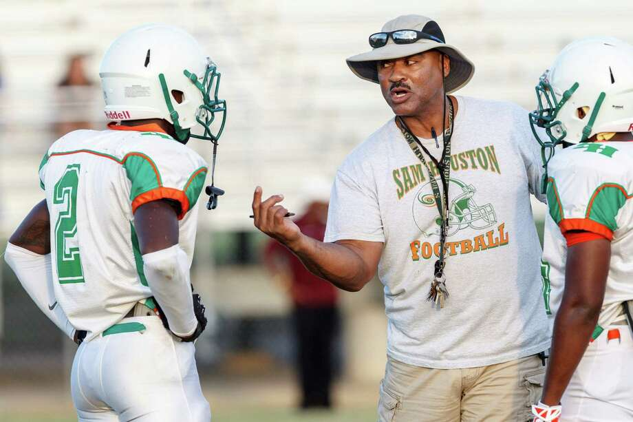 Sam Houston coach Gary Green talks to some of his players during a scrimmage with Burbank at the SAISD Sports Complex on Aug. 23, 2013. Photo: Marvin Pfeiffer /San Antonio Express-News / Prime Time Newspapers 2013