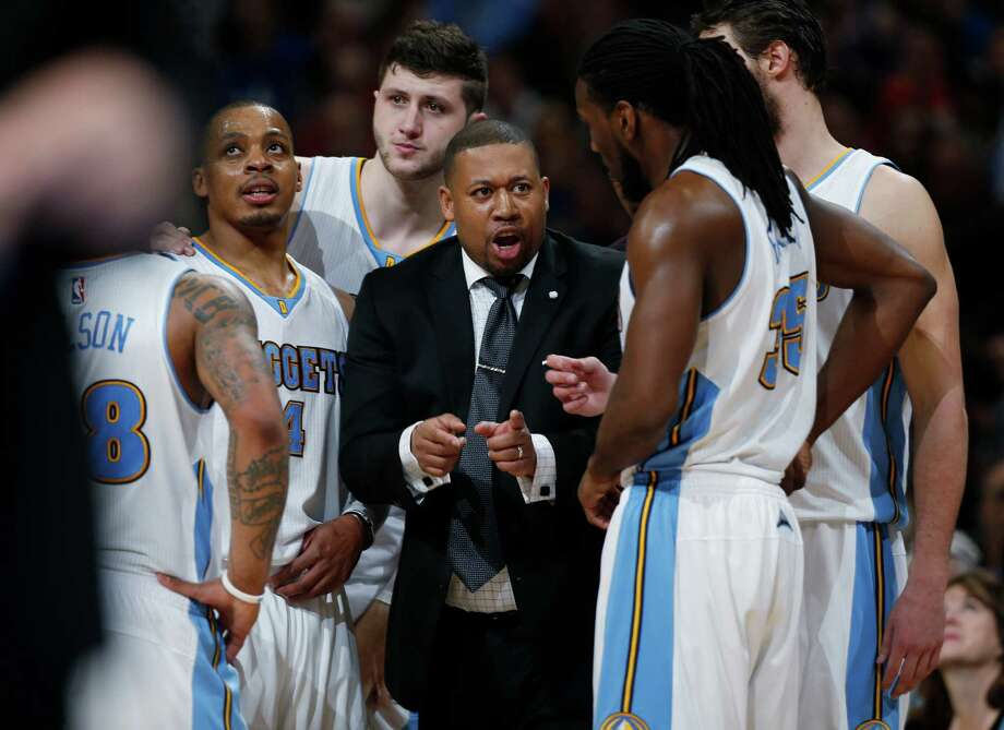 Denver Nuggets interim head coach Melvin Hunt confers with his players during a timeout against the Golden State Warriors in the fourth quarter on March 13, 2015, in Denver. The Nuggets won 114-103. Photo: David Zalubowski /Associated Press / AP