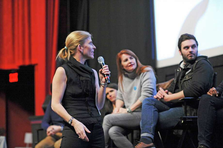 Anne Kern, on left, as program director of the Focus on French Cinema film festival, engages the creative team of the film âÄúOnce in a LifetimeâÄù or âÄúLes HeritiersâÄù post screening. In the center is the film director, Marie-Castille Mention-Schaar, with actor who played a student in the film. Photo: Contributed Photo / Greenwich Time Contributed