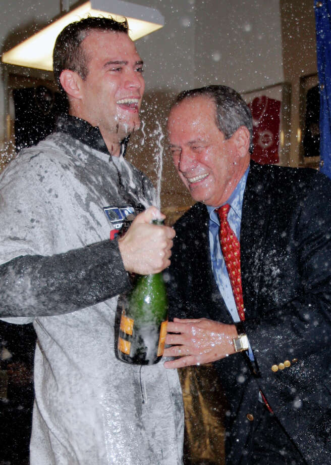 Theo Epstein (left) and team owner Larry Lucchino helped shape the Red Sox into champions, but a rift between the two paved the way for Epstein to move on to the Cubs. Photo: MIKE BLAKE / REUTERS / X00030