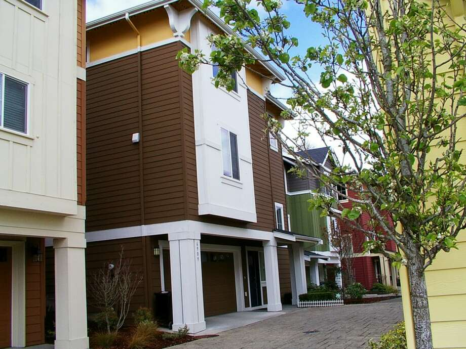 The first home, 6909 37th Ave. S., is listed for $450,000. The four bedroom, three-and-one-quarter bathroom was built in 2011, and offers easy access to  easy access to downtown Seattle and Bellevue.   There will be an open house this weekend on Sunday, April 5 from 1 - 4 p.m. See the full listing here. Photo: Courtesy Of Lily Wan
