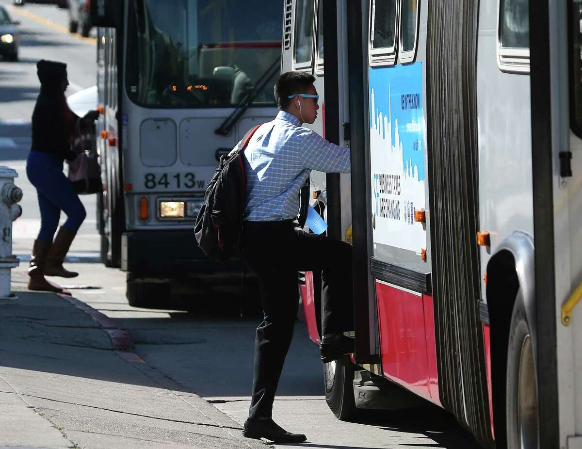 Passengers board Muni buses at San Bruno and Paul avenues in San Francisco on Thursday.