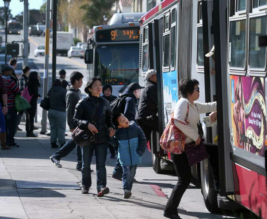 "Passengers board Muni buses at San Bruno and Paul avenues in San Francisco, Calif. on Thursday, April 2, 2015. The MTA will roll out its service improvement plan, dubbed ""Muni Forward"", later this month. Photo: Paul Chinn / The Chronicle / ONLINE_YES"