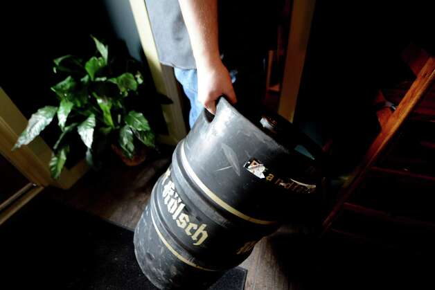 An empty keg is put away at Beer Belly Friday, March 27, 2015, on New Scotland Ave. in Albany, N.Y. (Will Waldron/Times Union) Photo: WW / 00031170A