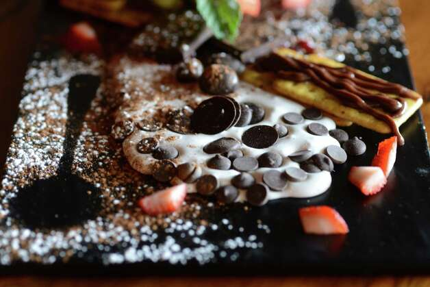 The chocolate chess board, a savory dessert board, at Beer Belly Friday, March 27, 2015, on New Scotland Ave. in Albany, N.Y. (Will Waldron/Times Union) Photo: WW / 00031170A