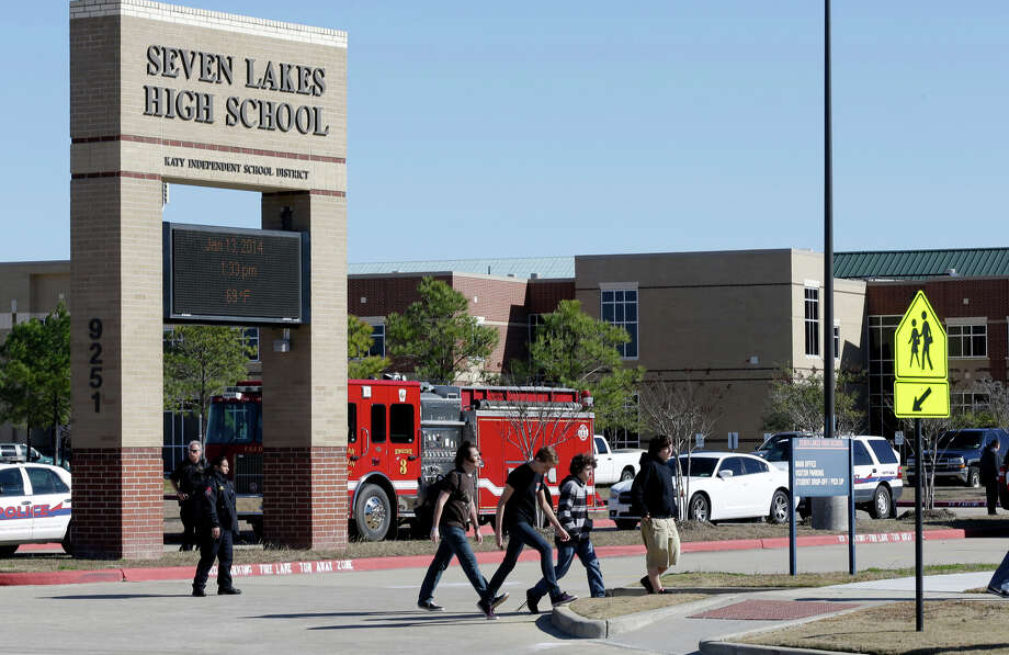 Students pass by Seven Lakes High School in Katy, Texas, last year after a suspicious device was found. Photo: Pat Sullivan / Associated Press / AP