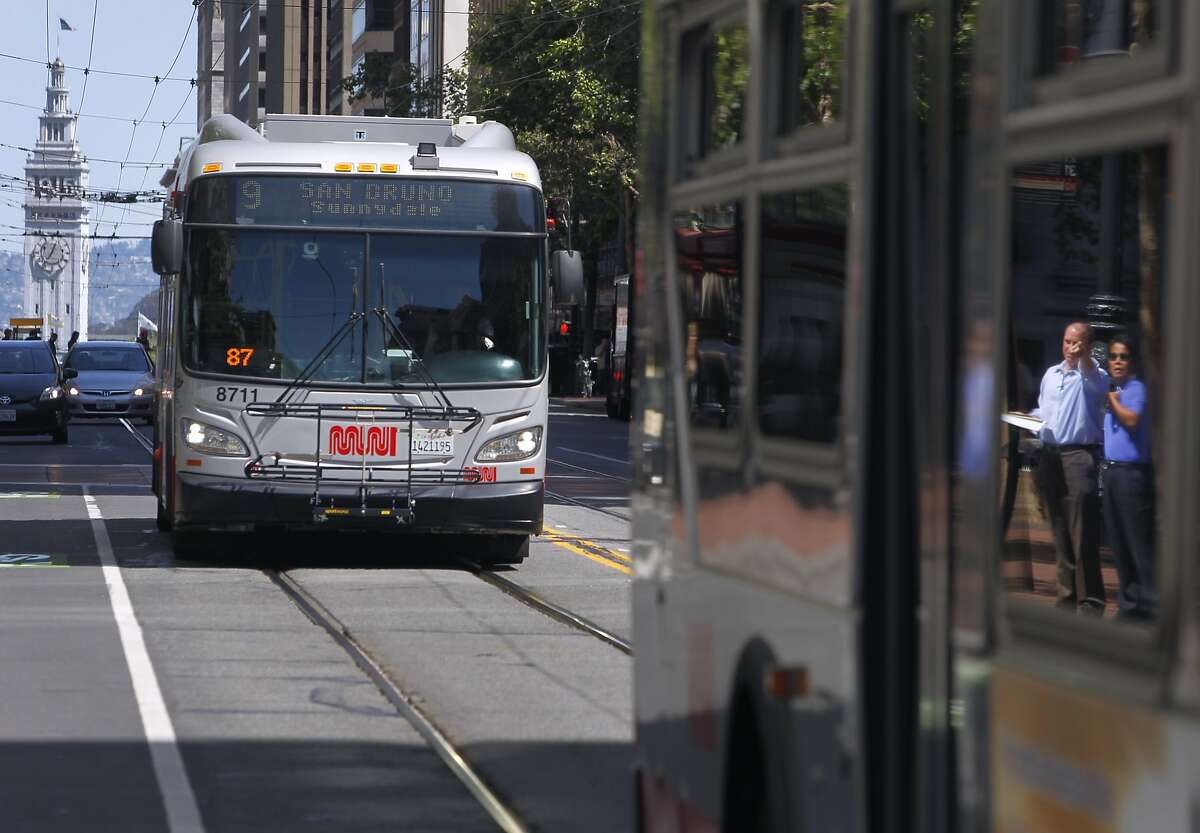 Muni buses roll down Market Street near Fourth Street in San Francisco, Calif. on Thursday, April 2, 2015. The MTA will roll out its service improvement plan, dubbed