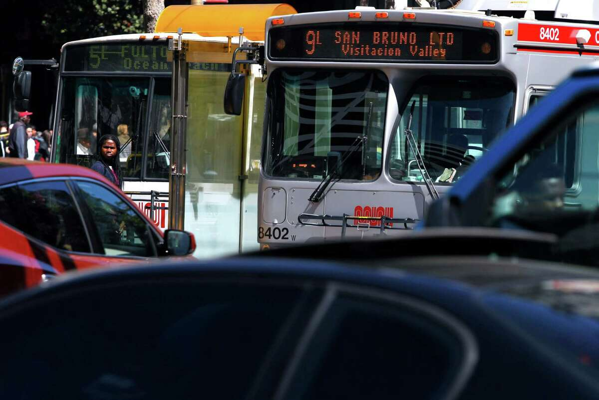 Muni buses roll down a congested section of Market Street in San Francisco, Calif. on Thursday, April 2, 2015. The MTA will roll out its service improvement plan, dubbed