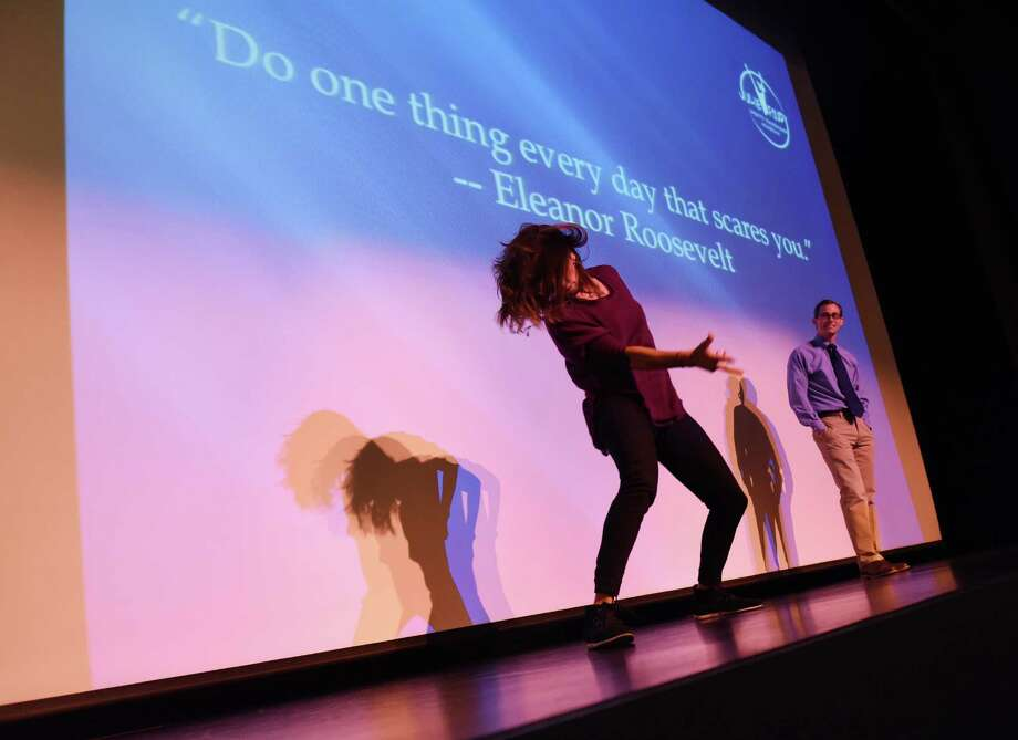 Julie Foudy, a captain of the World Cup-winning U.S. women's soccer team, busts a dance move as Mark Feiner, Associate Head of Schools, watches at Greenwich Academy in Greenwich, Conn. Thursday, April 2, 2015.  Foudy spoke about valuable lessons she has learned through her successful career in sports and how those lessons apply to everyday life. Photo: Tyler Sizemore / Greenwich Time