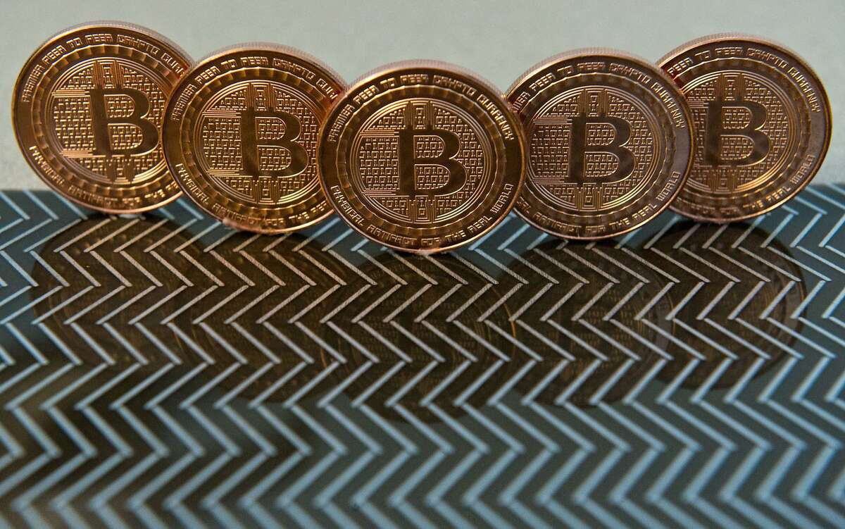 (FILES) This June 17, 2014 file photo photo taken in Washington, DC shows bitcoin medals. Noble Markets said March 24, 2015 it is adopting Nasdaq technology for its planned Bitcoin exchange, aiming to give institutional investors a credible platform for trading the digital currency. The startup said it would implement Nasdaq's X-stream Trading technology, already used by more than 30 smaller markets worldwide, to bring the Bitcoin trade to the Wall Street mainstream from often murky fringe exchanges. AFP PHOTO / Karen BLEIER / FILESKAREN BLEIER/AFP/Getty Images
