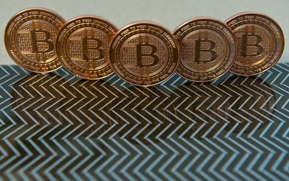 (FILES) This June 17, 2014 file photo photo taken in Washington, DC shows bitcoin medals. Noble Markets said March 24, 2015 it is adopting Nasdaq technology for its planned Bitcoin exchange, aiming to give institutional investors a credible platform for trading the digital currency. The startup said it would implement Nasdaq's X-stream Trading technology, already used by more than 30 smaller markets worldwide, to bring the Bitcoin trade to the Wall Street mainstream from often murky fringe exchanges. AFP PHOTO / Karen BLEIER / FILESKAREN BLEIER/AFP/Getty Images Photo: Karen Bleier, AFP / Getty Images