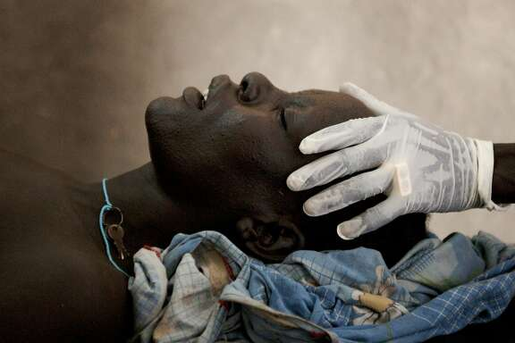 Southern Sudan, 2009 - A Nuer woman giving birth to her still-born baby.