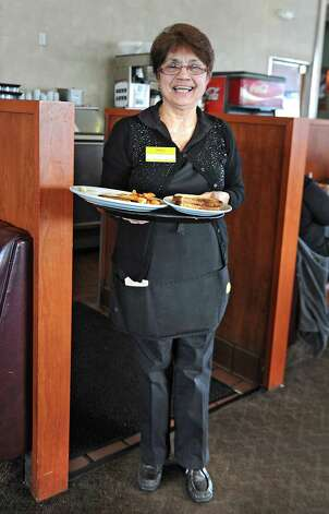Denny's waitress Kathy Morgan holds a tray of food on Wednesday, March 11, 2015 in Colonie, N.Y. Kathy has been a waitress at this Denny's for 40 years. (Lori Van Buren / Times Union) Photo: Lori Van Buren / 10030877A