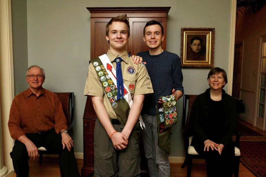 Pascal Tessier, left, and his brother Lucien Tessier, both earned the rank of Eagle Scout. Pascal's hiring by a Scout camp challenges Scouting policy. Photo: Jacquelyn Martin, STF / AP