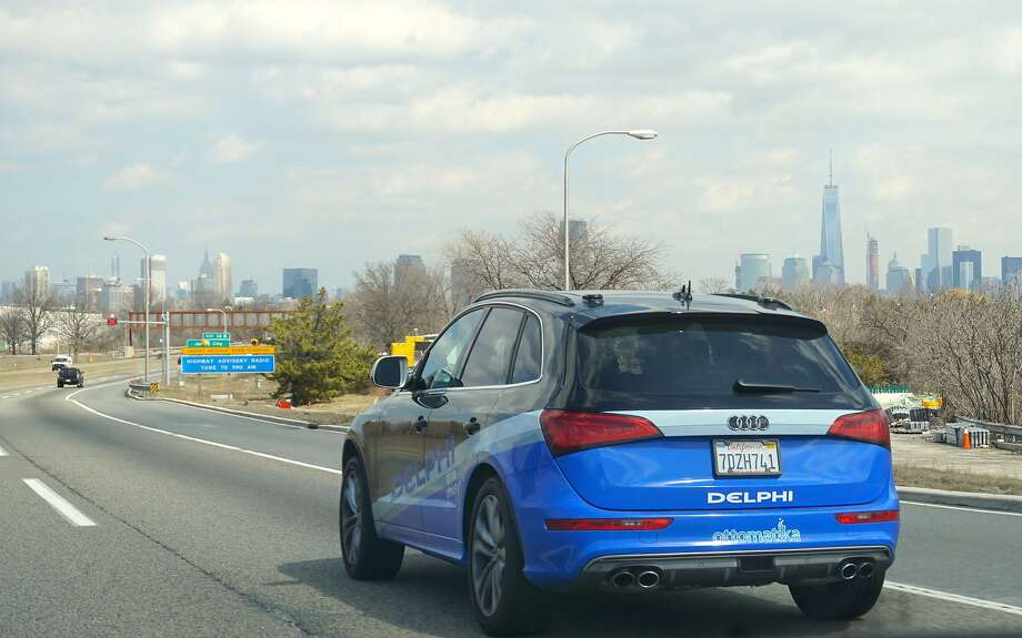 In this Monday, March 30, 2015 photo provided by Delphi Corp., the company's autonomous car approaches New York City, its final destination of a 3,400-mile road trip across the U.S., near Jersey City, N.J. Ninety-nine percent of the time, the car steered itself; only in very tricky situations, like a construction zone, did drivers take control. Now engineers will take the reams of data from the trip and use it to further advance autonomous technology. (AP Photo/Delphi Corp.) Photo: Uncredited, Associated Press