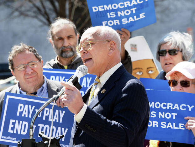 US Representative Paul Tonko, center, speaks at a rally calling on President Barack Obama to require federal contractors to disclose their political spending, and a demand to end corruption in NYS government Thursday April 2, 2015 in Albany, NY.   (John Carl D'Annibale / Times Union) Photo: John Carl D'Annibale, Albany Times Union / 00031239A