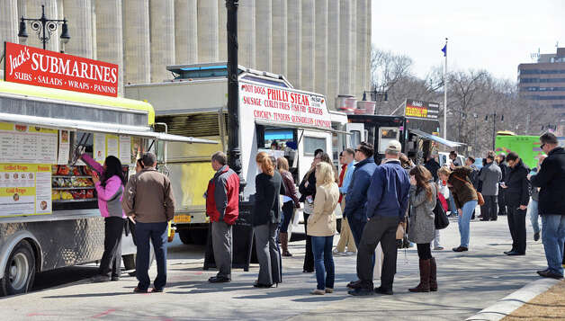 Food vendors and the lunchtime crowd take advantage of sunny spring weather at the Capitol Thursday April 2, 2015 in Albany, NY.   (John Carl D'Annibale / Times Union) Photo: John Carl D'Annibale, Albany Times Union