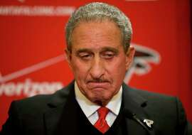 Atlanta Falcons owner Arthur Blank speaks at a 2014 news conference in after the NFL fined the team over noise at home games.