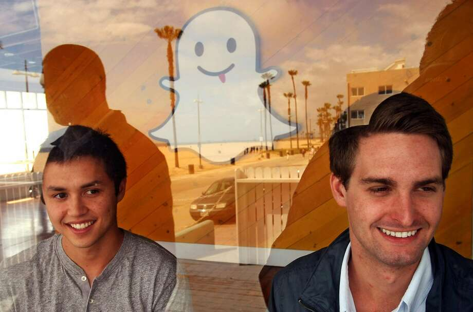 Bobby Murphy, 24, left, and Evan Spiegel, 22, co-creators of Snapchat, are seen through a window of the company's offices on Ocean Front Walk on May 6, 2013 in Venice, Calif. In 2013, co-founder Reggie Brown sued his former colleages and venture capitalists, alleging breach of contract. (Genaro Molina/Los Angeles Times/TNS) Photo: Genaro Molina, McClatchy-Tribune News Service
