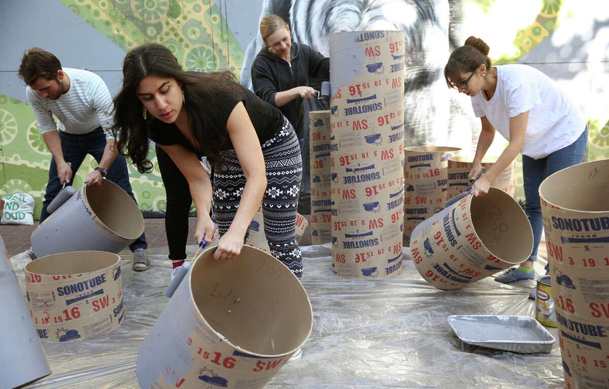 "Matt Adams (left), Lily Nikzad (front), Cassiopeia McDonald and Katie Marazita create the installation ""Show Box."""