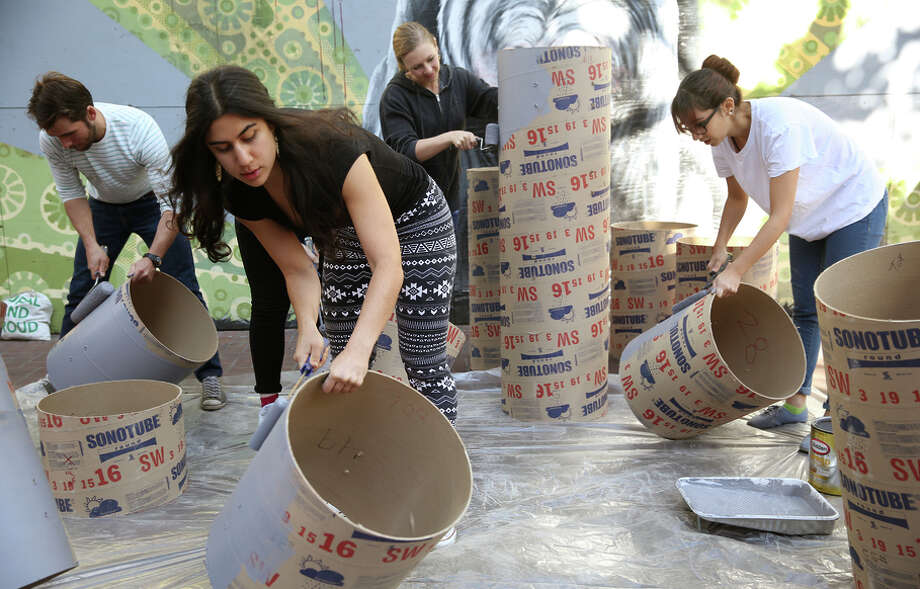 "Matt Adams (left), Lily Nikzad (front), Cassiopeia McDonald and Katie Marazita create the installation ""Show Box."" Photo: Liz Hafalia / The Chronicle / ONLINE_YES"