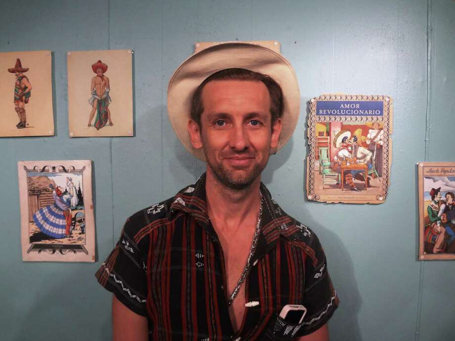 Mexico City artist Felix D'Eon hopes to strip gay and lesbian love of its taboos with his paintings inspired by vintage imagery. Photo: Photos By Steve Bennett /San Antonio Express-News