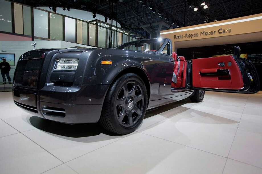 The Rolls-Royce Motor Cars Ltd. Phantom Drophead coupe vehicle is displayed during the 2015 New York International Auto Show in New York, U.S., on Wednesday, April 1, 2015. The 115th New York International Auto Show, which runs from April 3-12, will reveal 60 plus cars and trucks as well as host a wide range of industry events attracting automobile executives and members of the media from around the world.  Photo: Michael Nagle, Bloomberg / © 2015 Bloomberg Finance LP