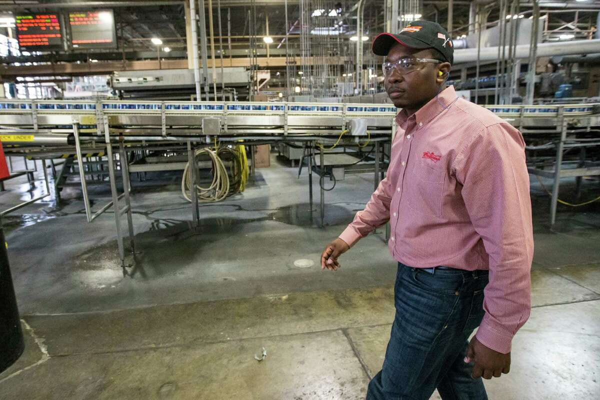 Damola Oshin, general manager, walks through the Anheuser-Busch Brewery on Thursday, April 2, 2015, in Houston. The brewery will soon resume offering tours for the first time in 19 years. ( Brett Coomer / Houston Chronicle )